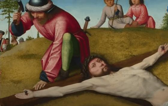 На фото изображено как Иисуса готовят к распятию.