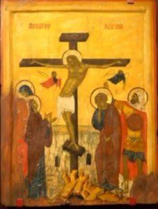Икона Распятье Иисуса Христа на золотистом фоне.